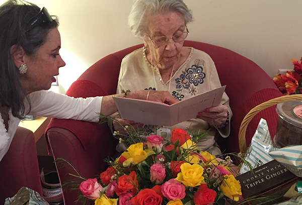 My oldest sister with my mom on mother's day. Showering her with flowers, sweets and heartfelt love!